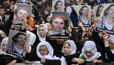 Pro-Kurdish demonstrators march with pictures of slain Kurdish activists during a protest in Istanbul